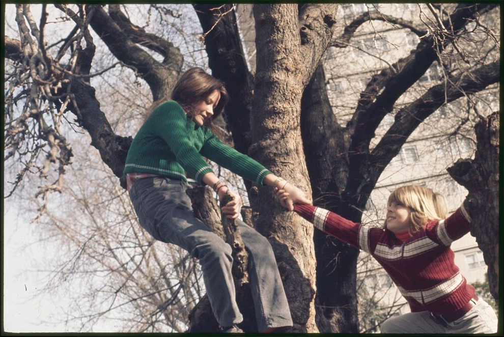 Two children climbing a tree, Collingwood, Victoria, 1970s. Photographer Rennie Ellis. State Library Victoria, H2012.140/1754
